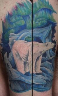 Colorful polar bear and aurora borealis tattoo