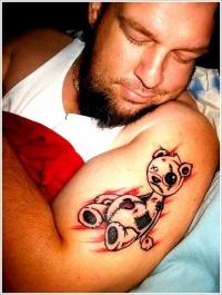Coloured teddy bear tattoo on half sleeve
