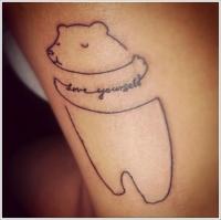 Cute hugging bear tattoo